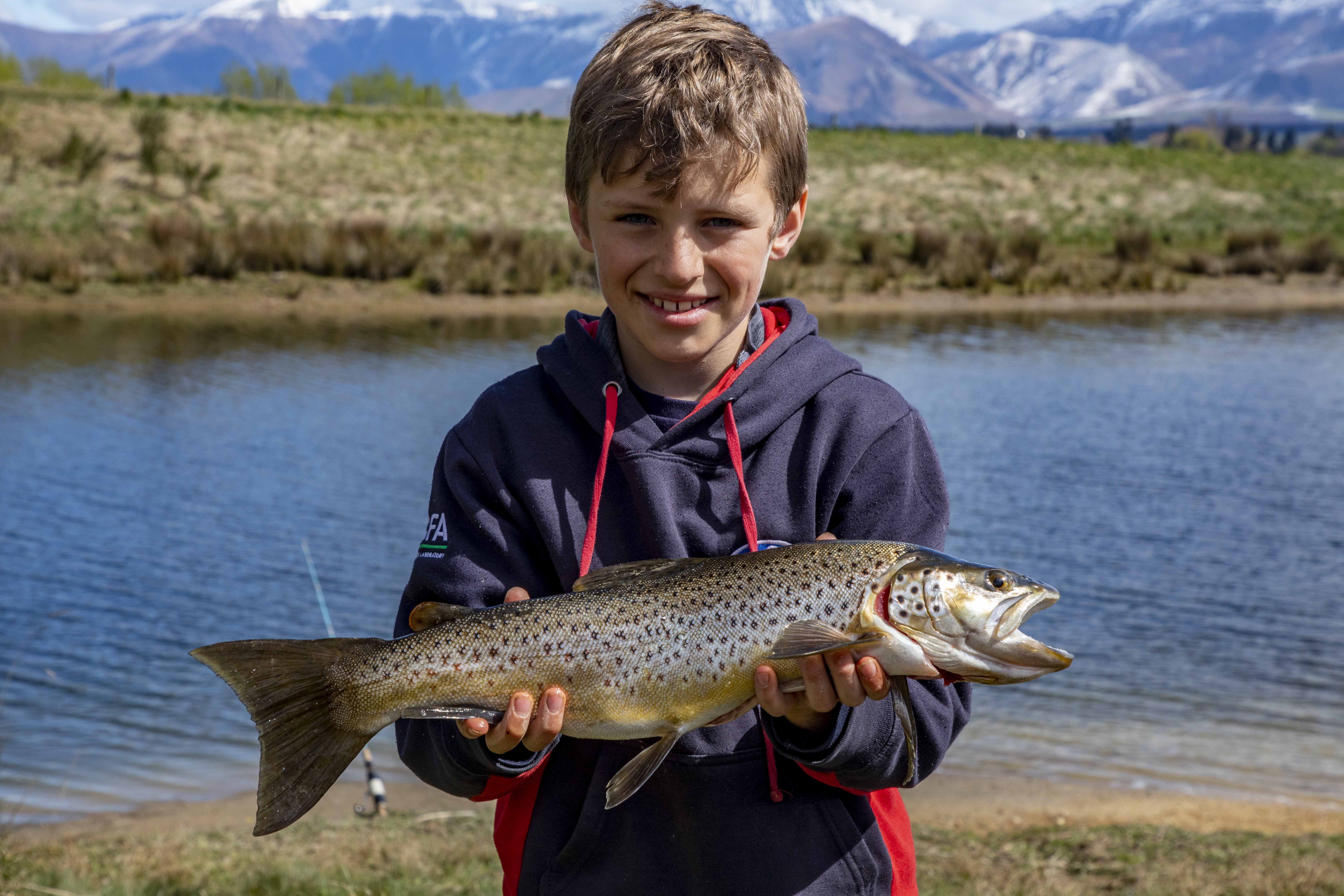 FGNZ7385a Nine year old Blake Marrett had success with wormfishing on Lake Opuha with this lovely brown trout