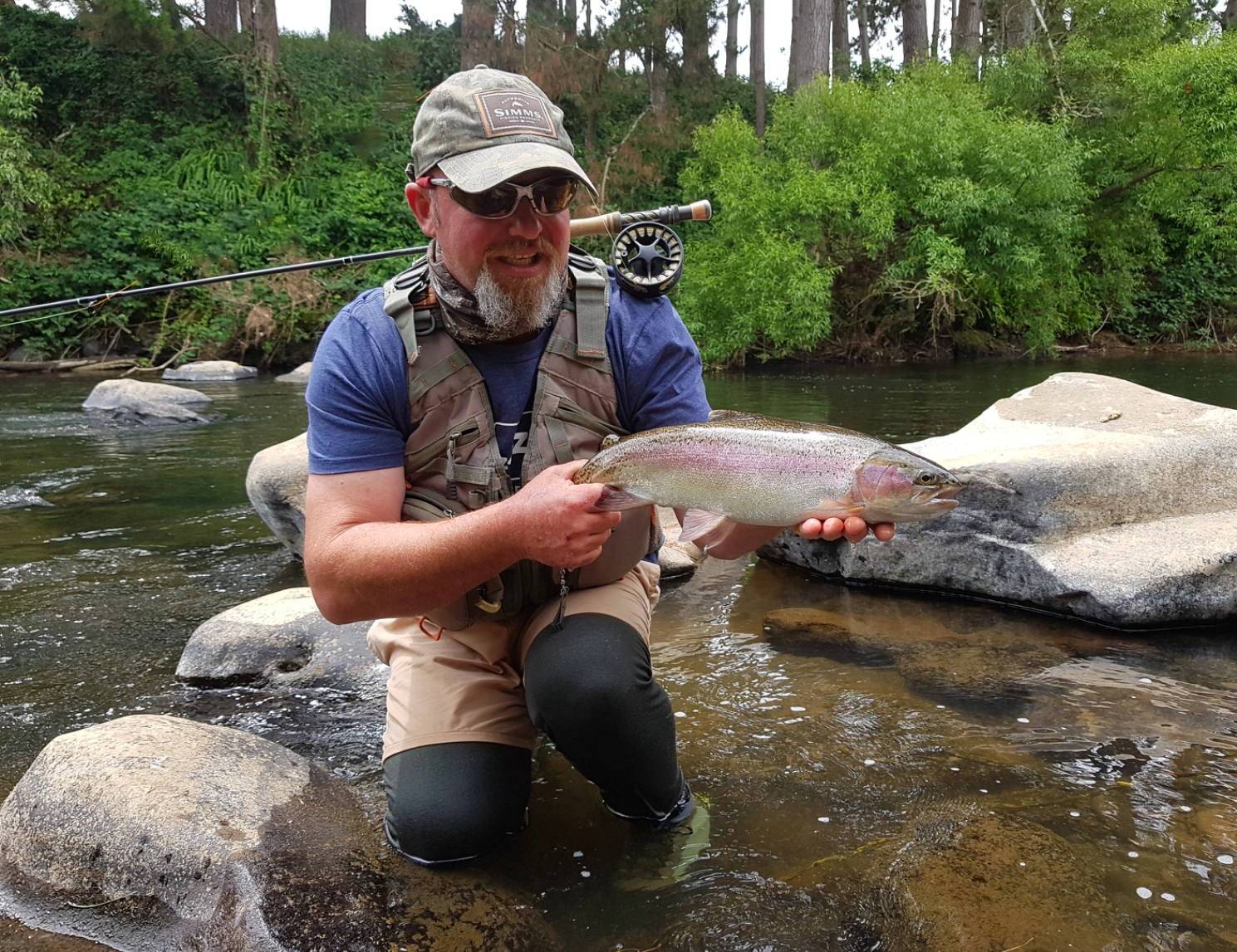 TRL1April18. Curly McEwen admires a well conditioned wild rainbow from the Waingongoro River Photo Tarn Mack McEwen