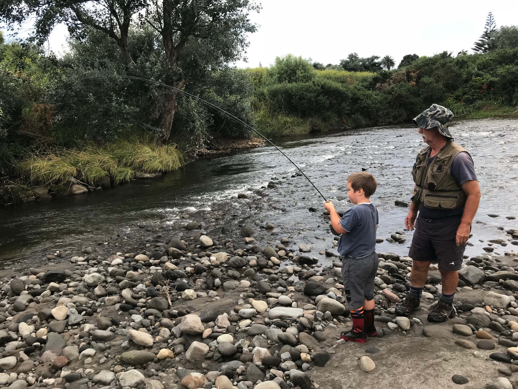 TRL2Sept19. Murray Dobbin watches on as grandson Wyatt plays a fish