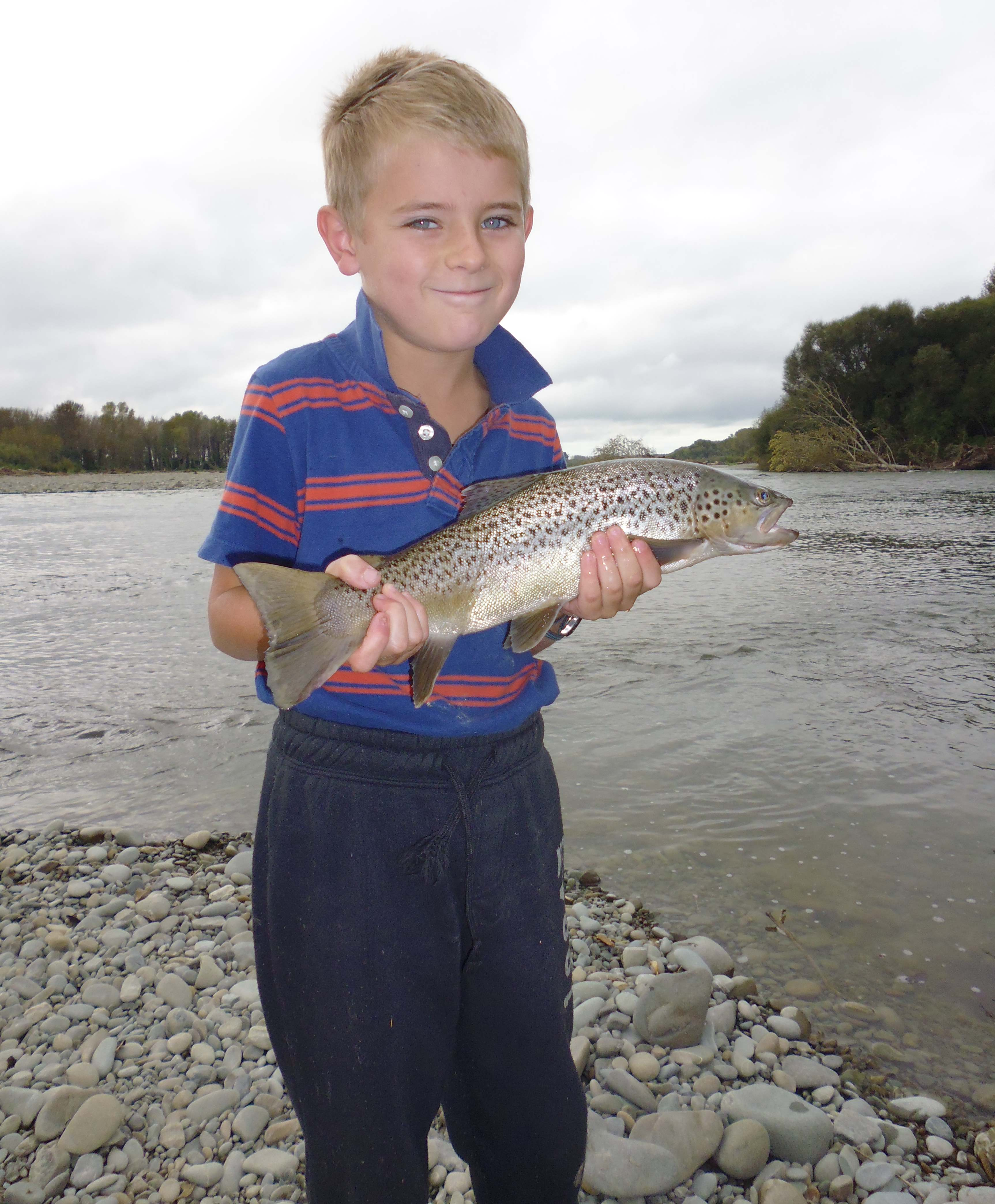 WFR1718.55 Cameron Blogg with his first fish a brown trout from the Opihi River