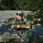 My son JR and his biggest fish to date, 3 1/2 lb brown. Taken on a cicada pattern. He landed and released 4 for the afternoon. Wellington, NZ. Photo from Mike Colbert