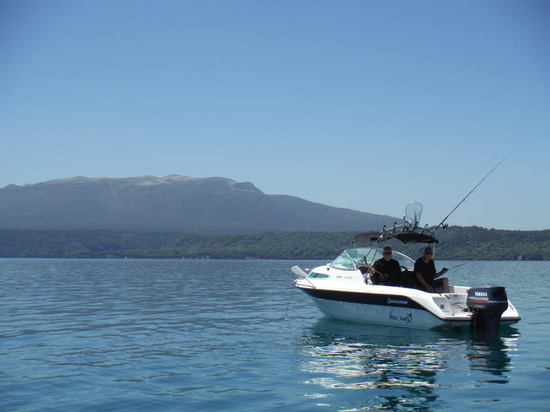 Anglers taking on some fine summer weather L Tarawera