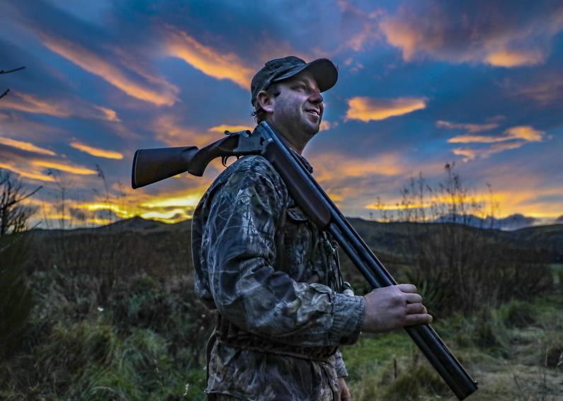 Dr Phil Lavretsky waits for incoming birds during a sunset hunt in Canterbury4.