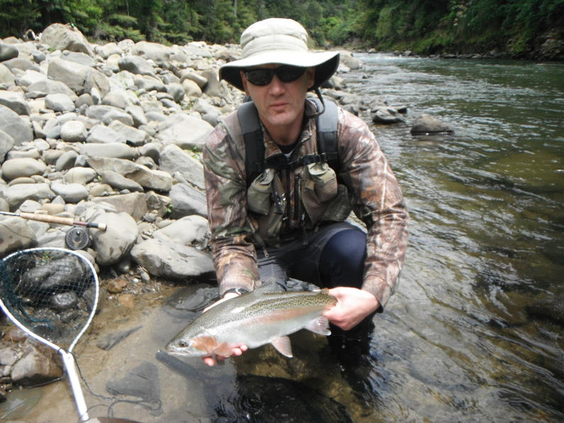 Mike Bodie with a rainbow from the Waioeka River Photo Fish Game