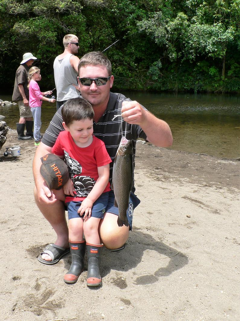 TRL2Dec18. Blake Bevins and proud dad admire the rainbow trout they caught at the recent Stratford kids fishing day.