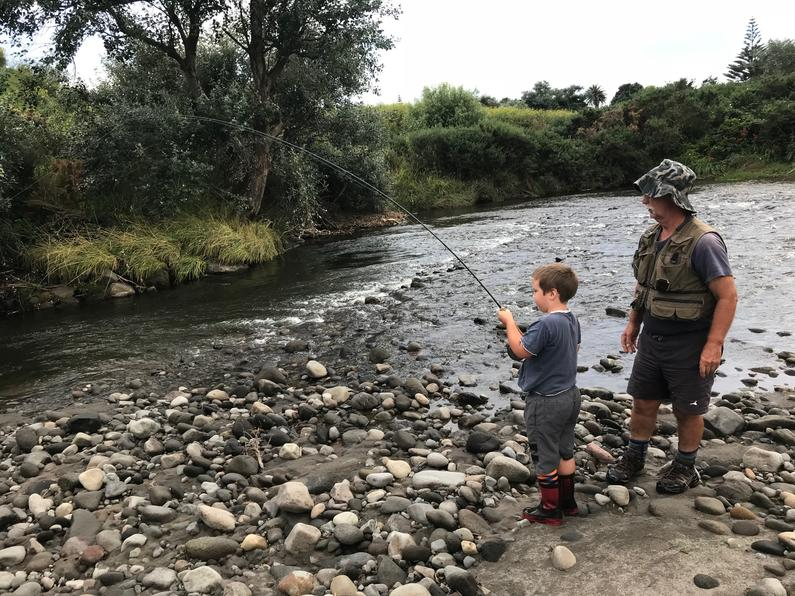 TRL2Sept18. Murray Dobbin watches on as grandson Wyatt plays a fish