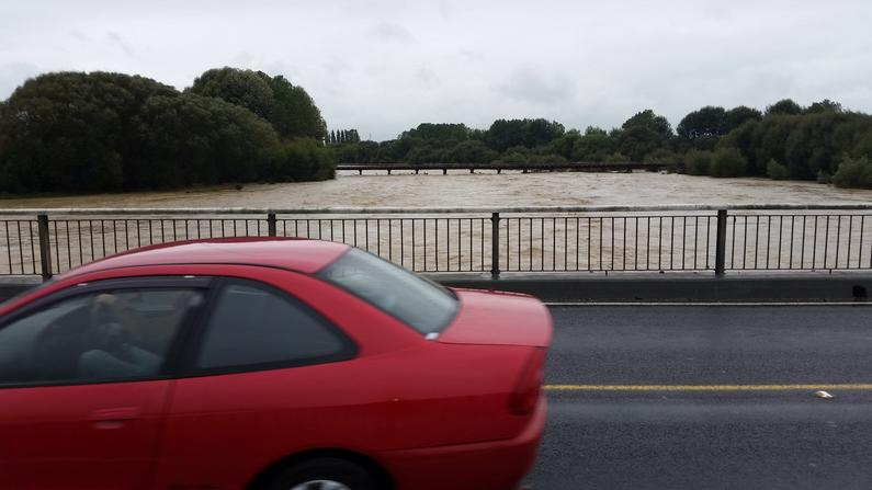 WFR1718.41The flooded Temuka River flows at about 530 cumecs at SH110am on February 21