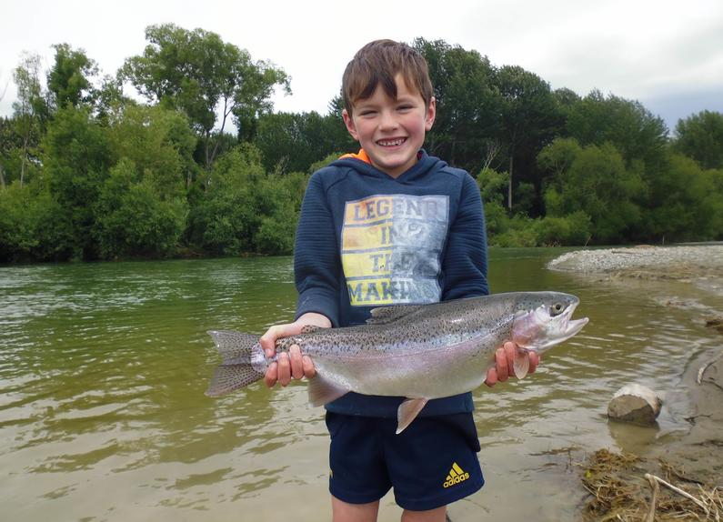 WFR1819.24 Finn Stevens display his rare catch a rainbow trout from the Opihi River photo credit H Stevens