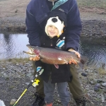 7 year old Josh casted hooked and landed his first trout weighing 6.8lbs. One happy  kid!